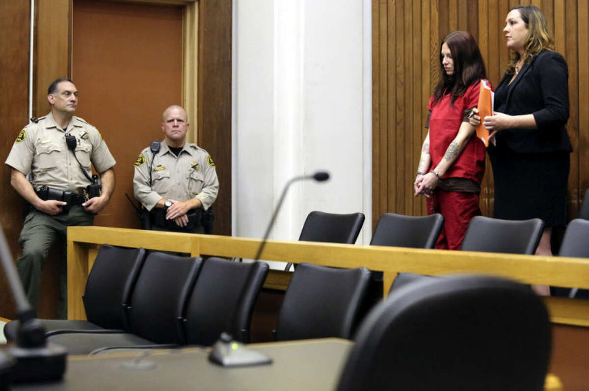 Alix Tichelman, second from left, stands next to her public defender Athena Reis as she is arraigned in Santa Cruz County Superior Court on Wednesday, July 16, 2014, in Santa Cruz, Calif. Tichelman, faces manslaughter charges in the death last November of Forrest Hayes, a Google executive after she walked away from him when he overdosed on heroin on his yacht. (AP Photo/Santa Cruz Sentinel, Shmuel Thaler, Pool)