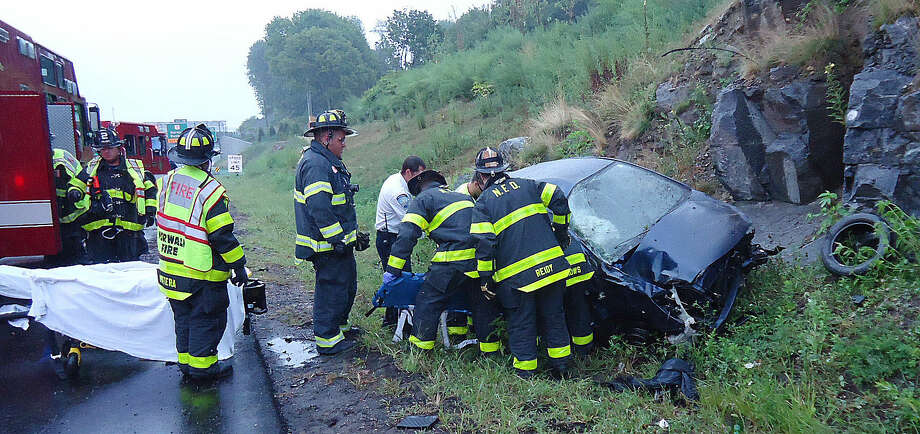 Contributed photoNorwalk Firefighters respond to a rollover accident on I-95 on Friday morning.