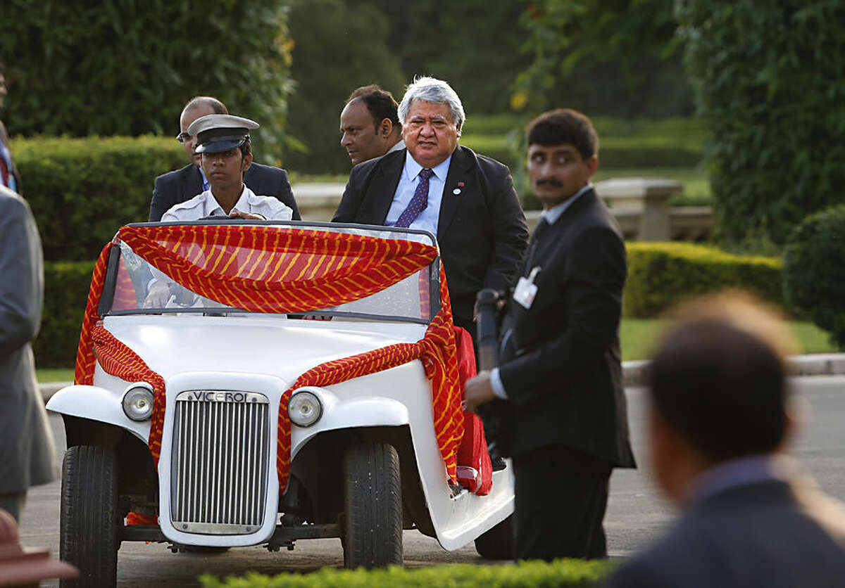 Samoa Prime Minister Tuilaepa Lupesoliai Sailele Malielegaoi arrives in a golf cart for the Forum for India-Pacific Island Countries (FIPIC) Summit in Jaipur, India, Friday, Aug. 21, 2015. (AP Photo/Manish Swarup)