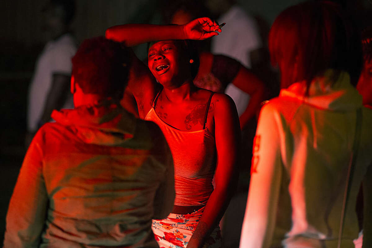 A young woman cries at the scene of a shooting at the Boys and Girls Club on Genesee Street, early Thursday, Aug. 20, 2015, in Rochester, N.Y. The gunman shot into a crowd that gathered outside the club after a basketball game, fatally wounding several people. (Lauren Petracca/Democrat & Chronicle via AP) MAGS OUT; NO SALES; MANDATORY CREDIT