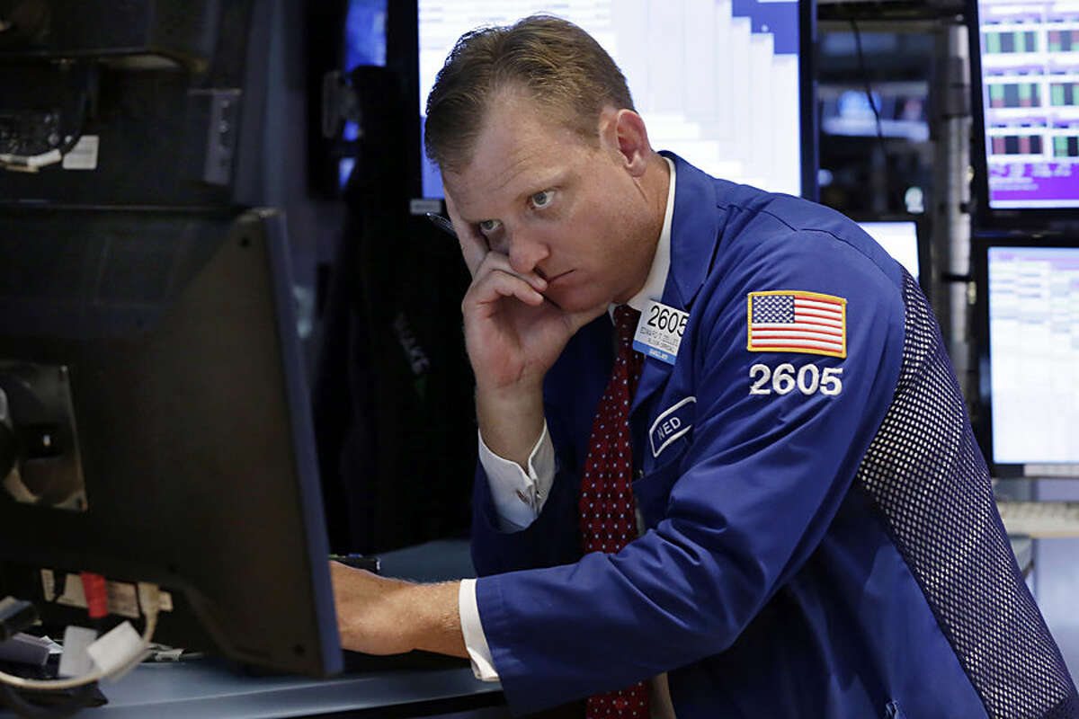 Specialist Edward Zelles works on the floor of the New York Stock Exchange, Thursday, Aug. 20, 2015. The Dow Jones industrial average slid 358 points, also 2.1 percent, to 16,990. (AP Photo/Richard Drew)