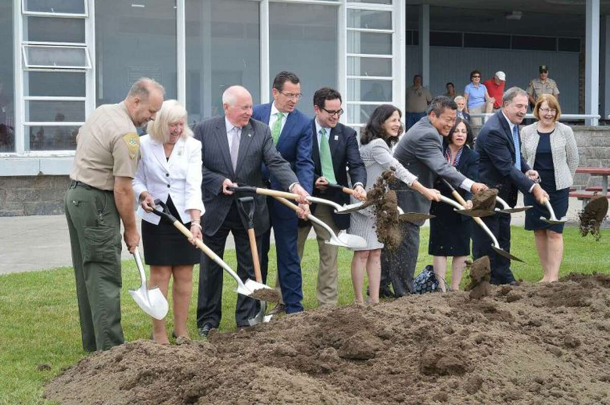 Hour Photo/Alex von Kleydorff Governor Dan Malloy and others break ground after making an announcement to renovate the Pavilion at Sherwood Island State Park in Westport.