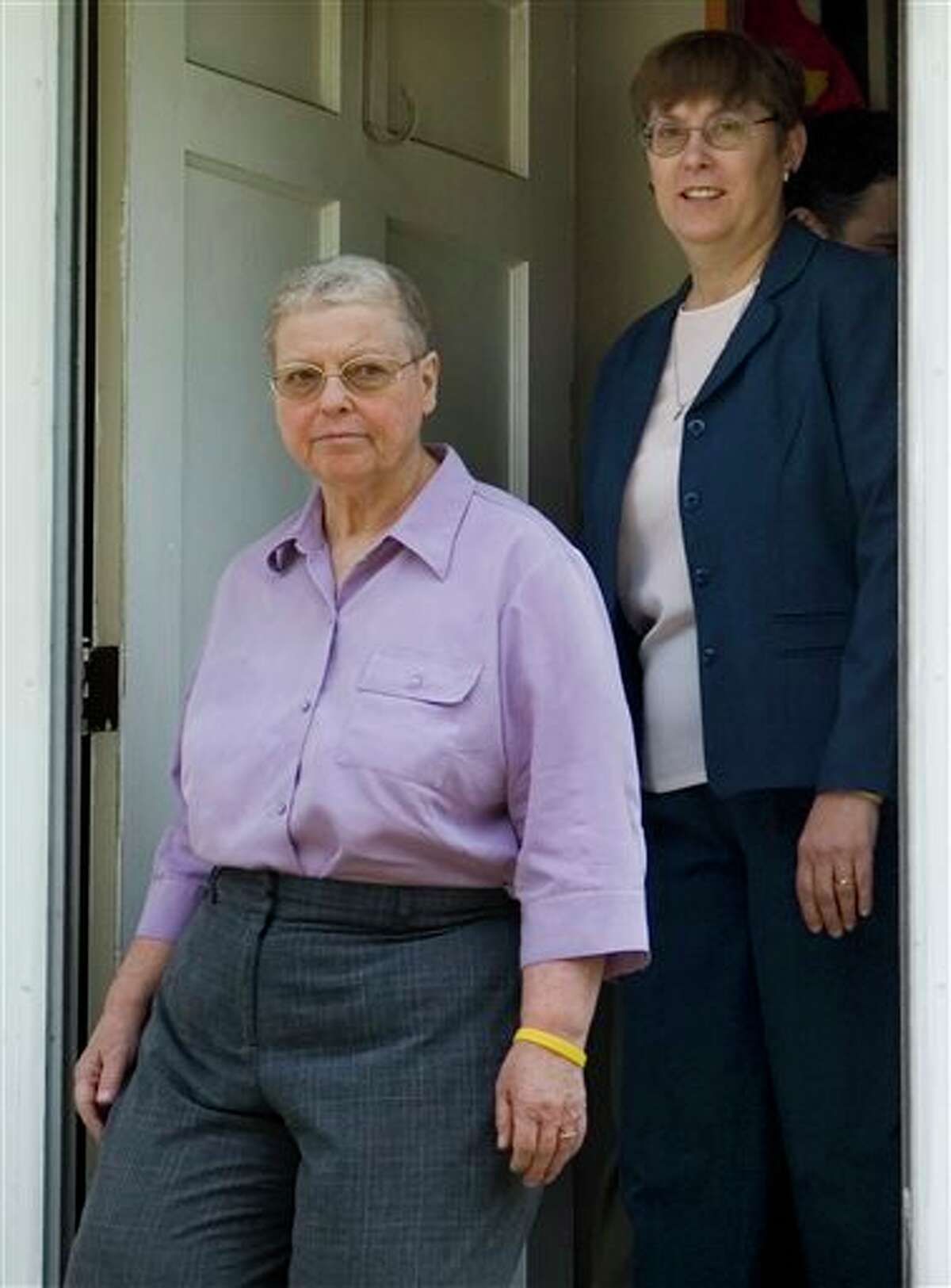 FILE - This July 18, 2006 file photo shows Margaret Mueller, right, and Charlotte Stacey at their home in Norwalk, Conn. Connecticut's highest court ruled Wednesday that some legal rights of same-sex couples predate the state's approvals of civil unions in 2005 and gay marriage in 2008, a decision that gay rights supporters call the first of its kind in the country. The case involved Mueller and Stacey who had a civil union in Connecticut in 2005 and got married in Massachusetts in 2008 after 23 years together under that state's gay marriage law, shortly before the Connecticut Supreme Court approved gay marriage. (AP Photo/Douglas Healey)