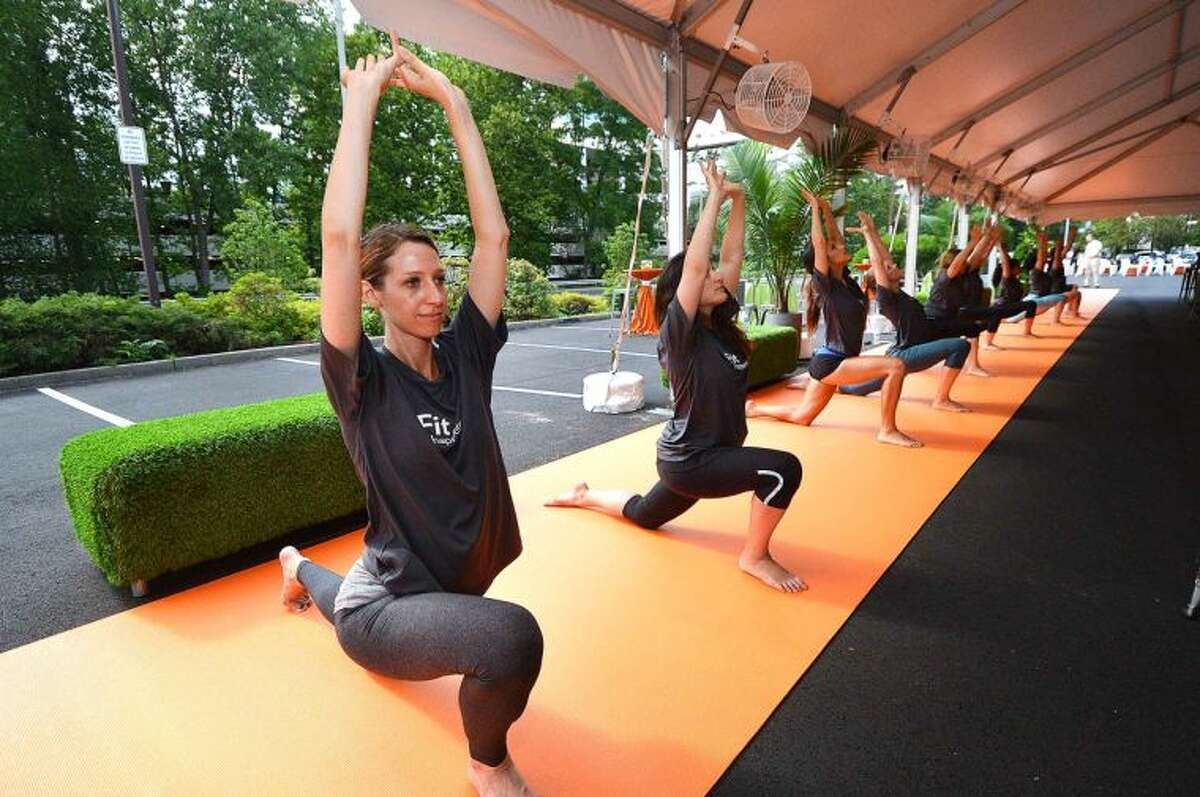 Hour Photo/Alex von Kleydorff The long Yoga Mat gets some use at Even Hotels newest property opening in Norwalk