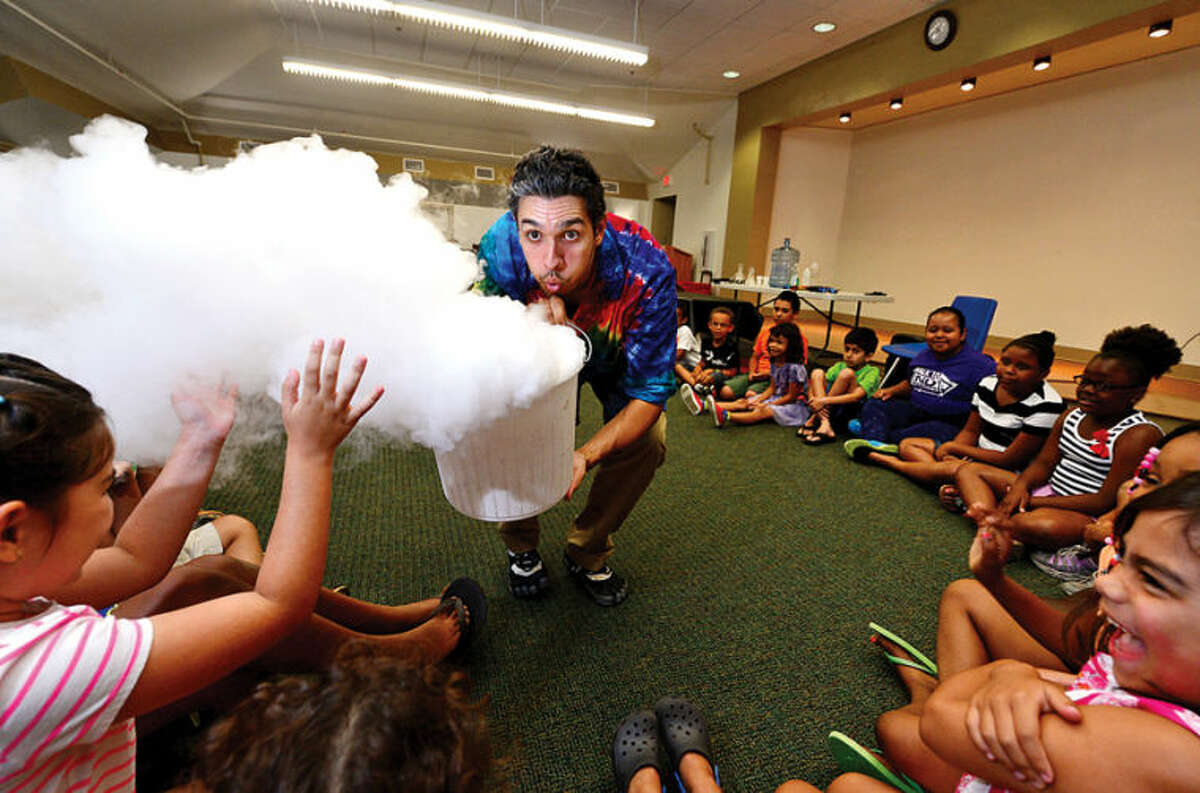 Hour photo / Erik Trautmann Interactive science storyteller, Justin Maruri, otherwise known as a Scienceteller, uses dry ice during his presentation