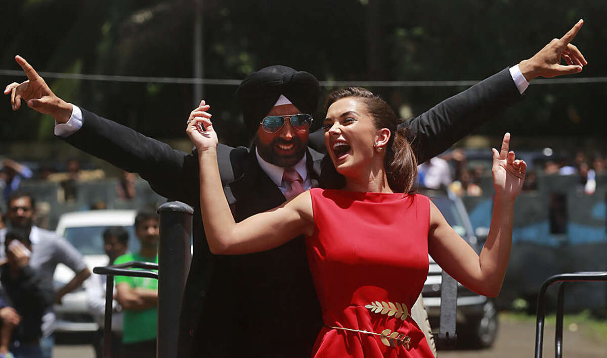 Indian Bollywood actor Akshay Kumar, left, and actress Amy Jackson perform during the trailer laugh of their upcoming film