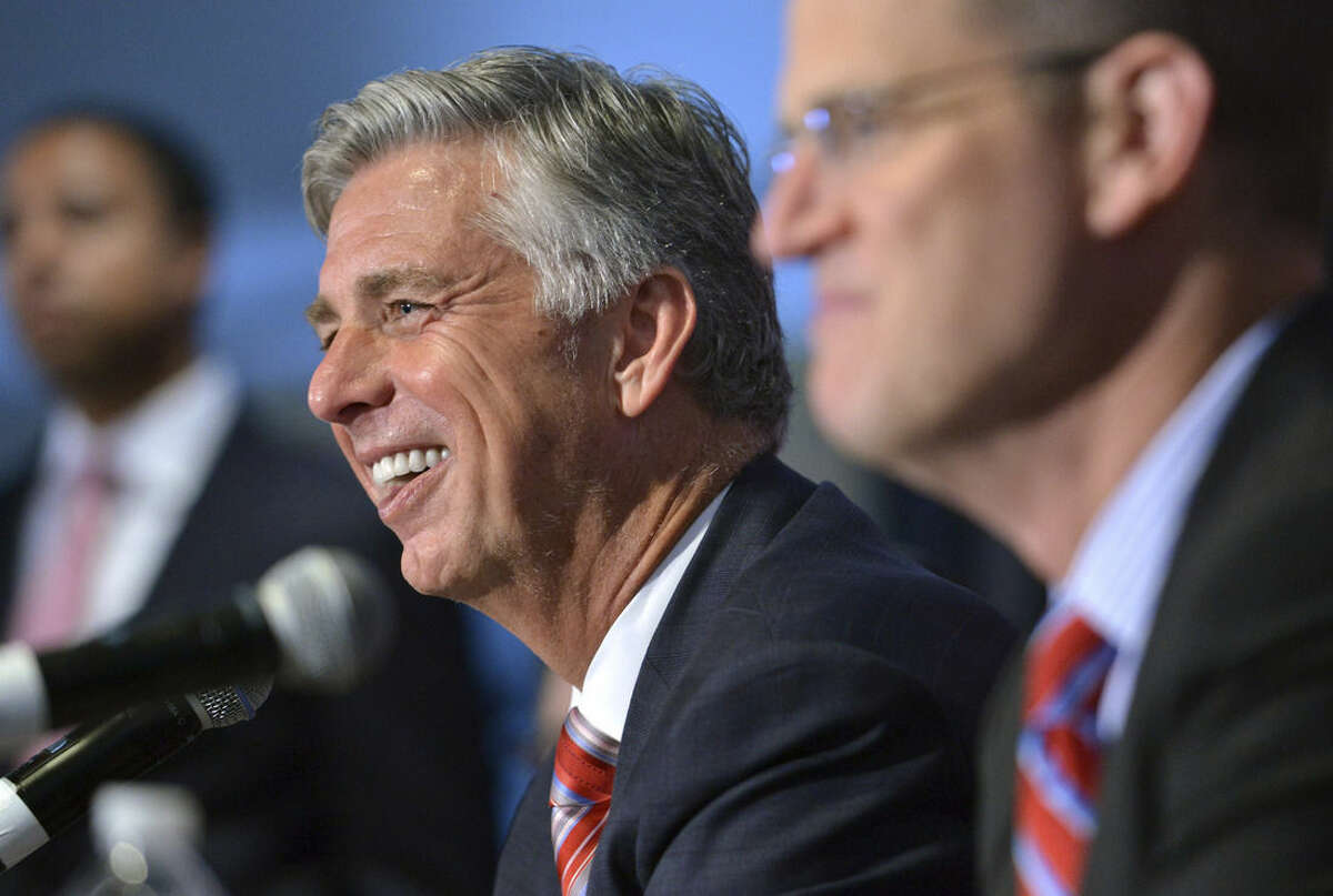 Dave Dombrowski, center, the Boston Red Sox new president of baseball operations, speaks to reporters after being introduced at a baseball news conference Wednesday, Aug. 19, 2015, at Fenway Park in Boston. (AP Photo/Josh Reynolds)