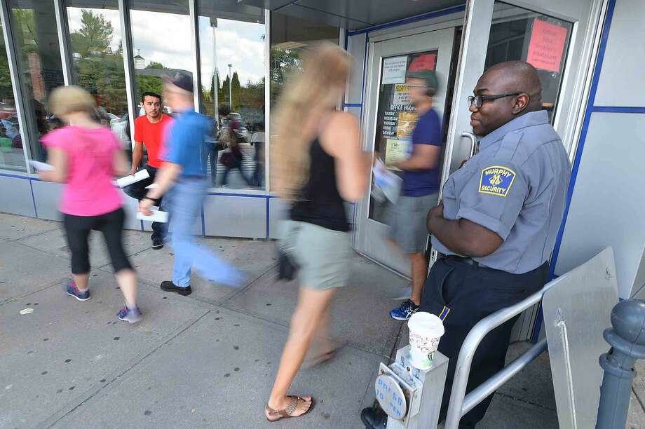 Hour Photo/Alex von Kleydorff People enter and leave the DMV office on Main Ave in Norwalk on Wednesday,