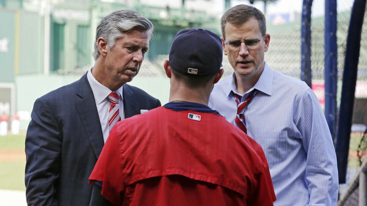 Dave Dombrowski, left, the Boston Red Sox's new president of baseball operations, and Sam Kennedy, executive vice president, talk with second baseman Dustin Pedroia, center, during batting practice before the Red Sox's baseball game against the Cleveland Indians at Fenway Park in Boston, Wednesday, Aug. 19, 2015. (AP Photo/Charles Krupa)
