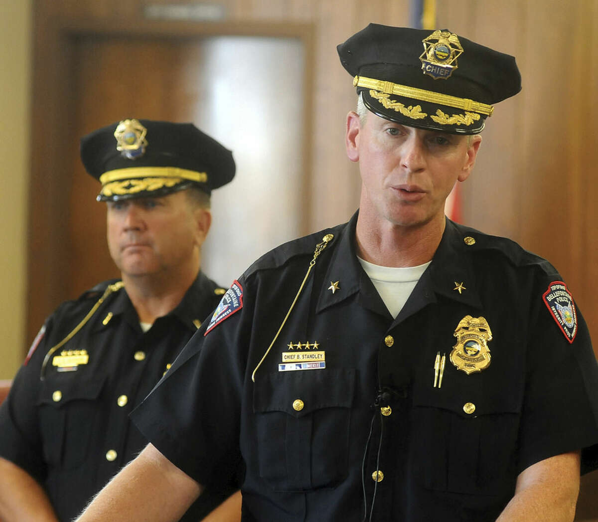 In this Tuesday, Aug. 18, 2015, photo, Bellefontaine Police Chief Brandon Standley, front, and Lt. Rick Herring host a news conference, in Bellefontaine, Ohio, to announce charges against Brittany Pilkington. Pilkington was charged with three counts of murder and was jailed, after authorities said she confessed to killing her three young sons. (Reuben Mees/Bellefontaine Examiner via AP) MANDATORY CREDIT