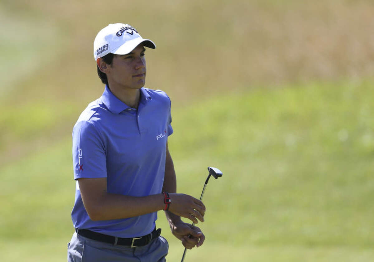 Matteo Manassero of Italy prepares to putt on the 13th green during the first day of the British Open Golf championship at the Royal Liverpool golf club, Hoylake, England, Thursday July 17, 2014. (AP Photo/Scott Heppell)