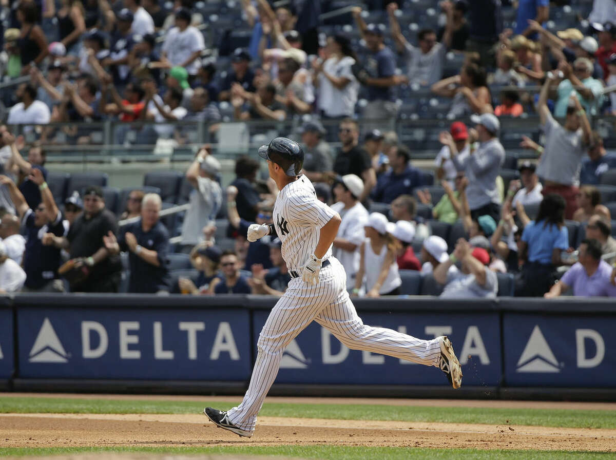 New York Yankees' Greg Bird rounds the bases after hitting a two-run home run to right field during the fourth inning of a baseball game against the Minnesota Twins, Wednesday, Aug. 19, 2015, in New York. It was Bird's first major league home run. (AP Photo/Julie Jacobson)