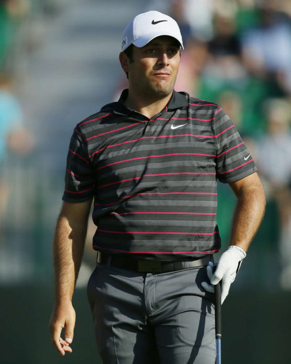 Francesco Molinari of Italy watches his shot along the 4th fairway during the first day of the British Open Golf championship at the Royal Liverpool golf club, Hoylake, England, Thursday July 17, 2014. (AP Photo/Alastair Grant)