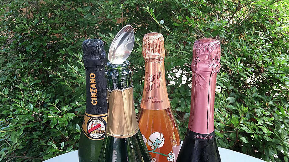 Photo by Frank Whitman Trying out the theory that a spoon placed into an open bottle of sparkling wine will keep it more bubbly.