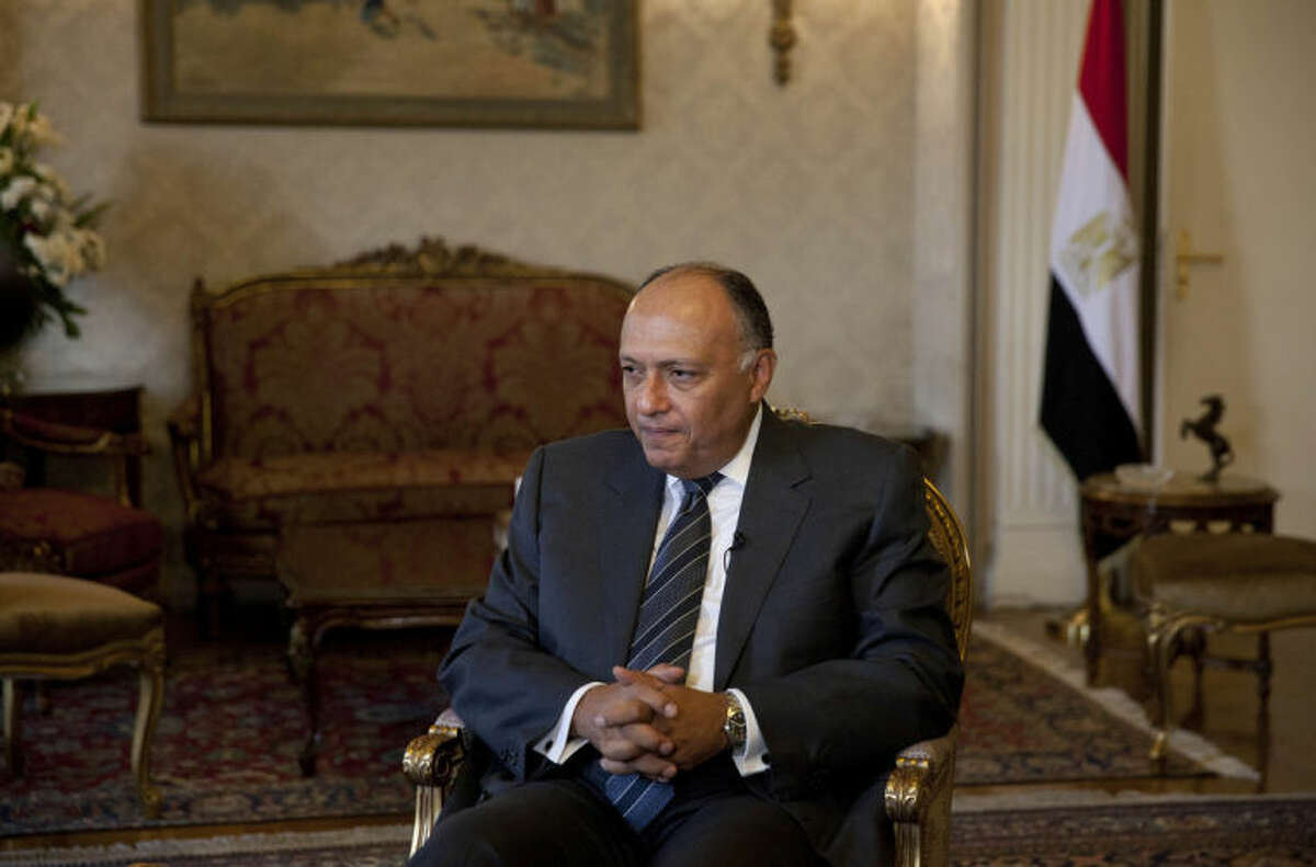 Egyptian Foreign Minister Sameh Shukri listens to a question during an interview with the Associated Press,Thursday, July 17, 2014 in Cairo, Egypt. Shukri says Egypt's proposal for a cease-fire between Israel and Gaza is gaining momentum, and that it is the only viable way to stop an ?