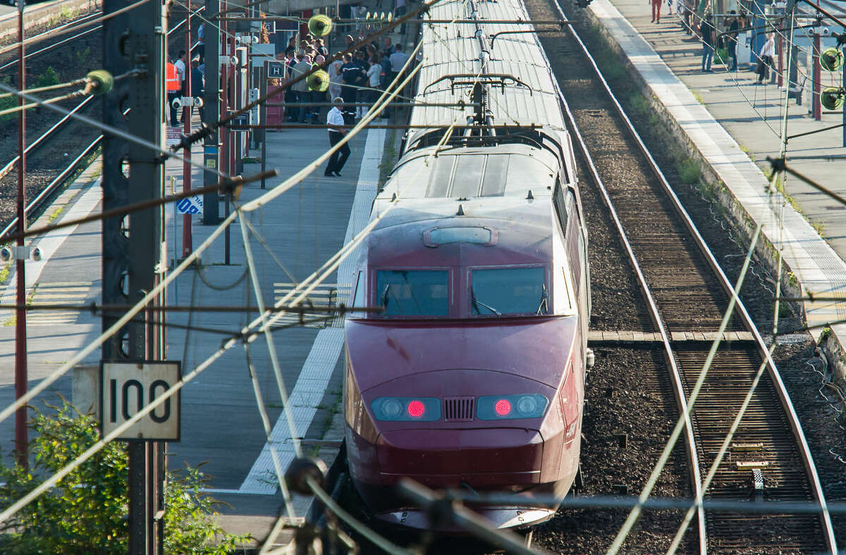A Thalys train of French national railway operator, SNCF, stands at the main train station in Arras, northern France, after a gunman opened fire injuring three people, Friday, Aug. 21, 2015. A spokesman for France's interior ministry says three people were wounded in a shooting on a high-speed train traveling from Amsterdam to Paris Friday. Speaking on French television BFM, Pierre-Henri Brandet says a suspect is in custody and the train has been evacuated in Arras, 115 miles (185 kilometers) north of Paris, where the train stopped after the attack. (AP Photo)