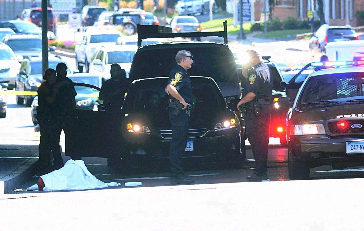 Hour Photo/Erik Trautmann Norwalk Police and EMS respond to a male victim who fell from the I-95 Bridge onto West Avenue Friday.
