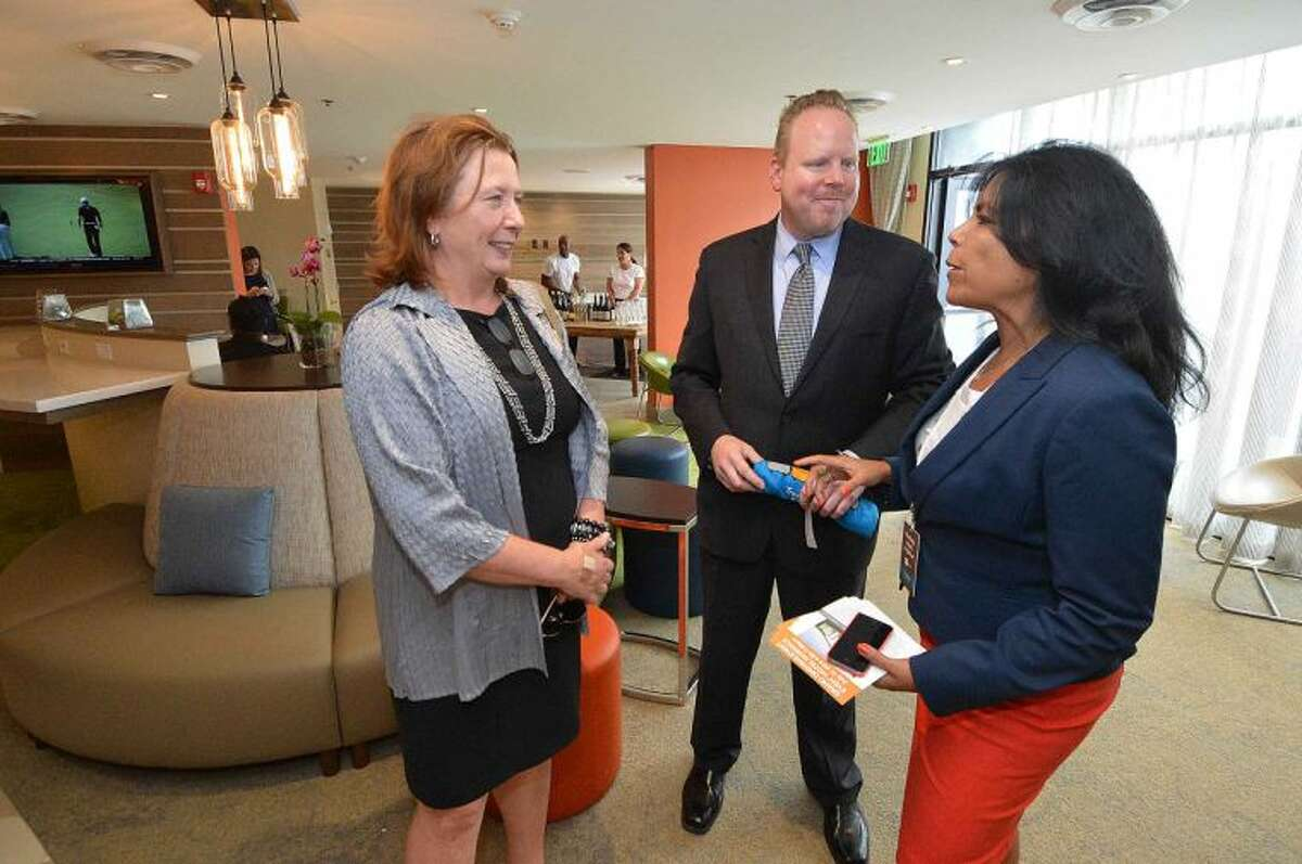 Hour Photo/Alex von Kleydorff Barbara Seiter with the Stamford Chamber of Commerce and Brian Griffith with the Norwalk Chamber get a tour of the hotel with Even Hotels Director of Sales Arleen Beradino