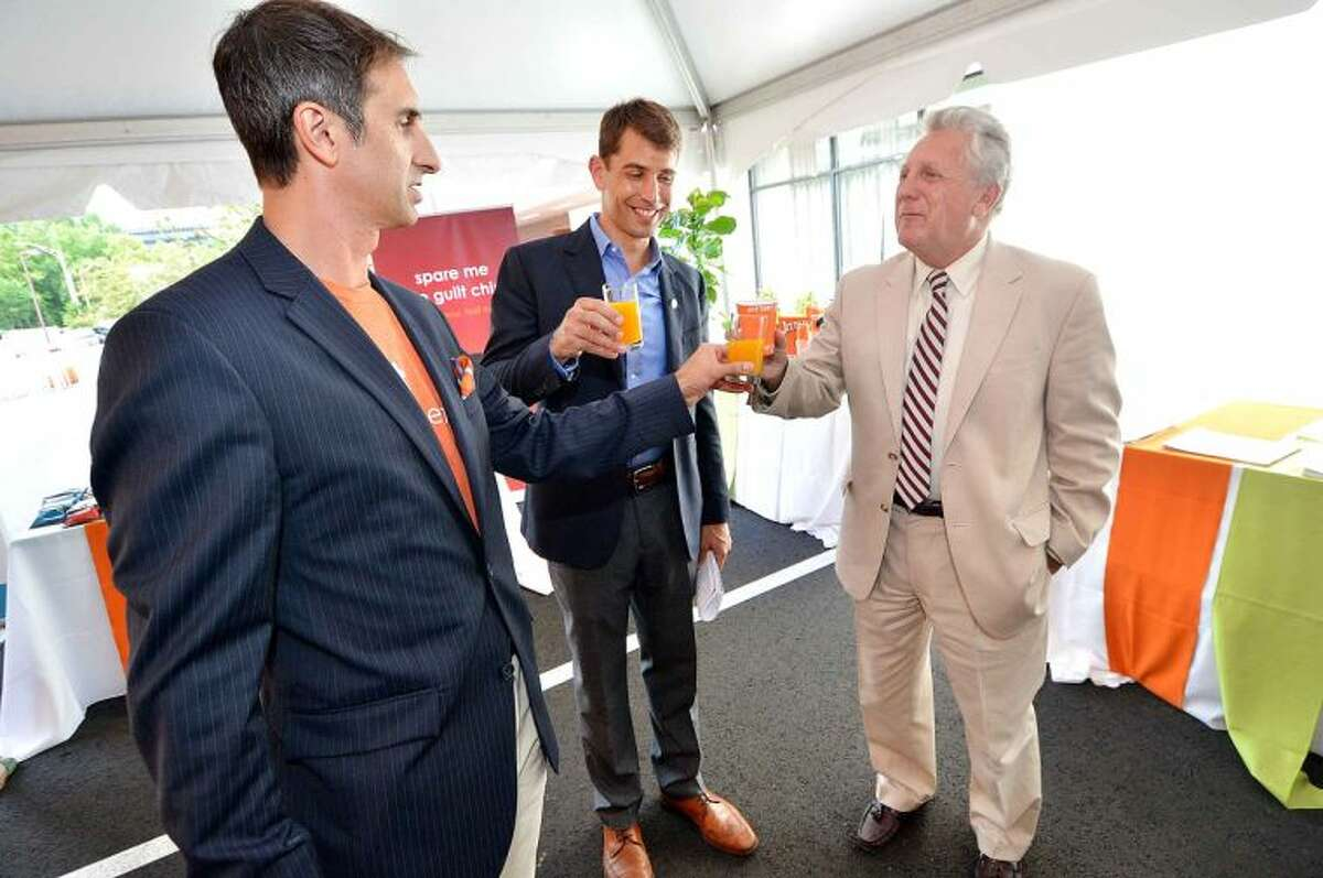 Hour Photo/Alex von Kleydorff Mayor Harry Rilligs toasts with some fesh squeezed orange juice with Even Hotel Fitness Consultant Jim Kaese and Drew Ramsey M.D. who created the menu for the hotel during the opening reception