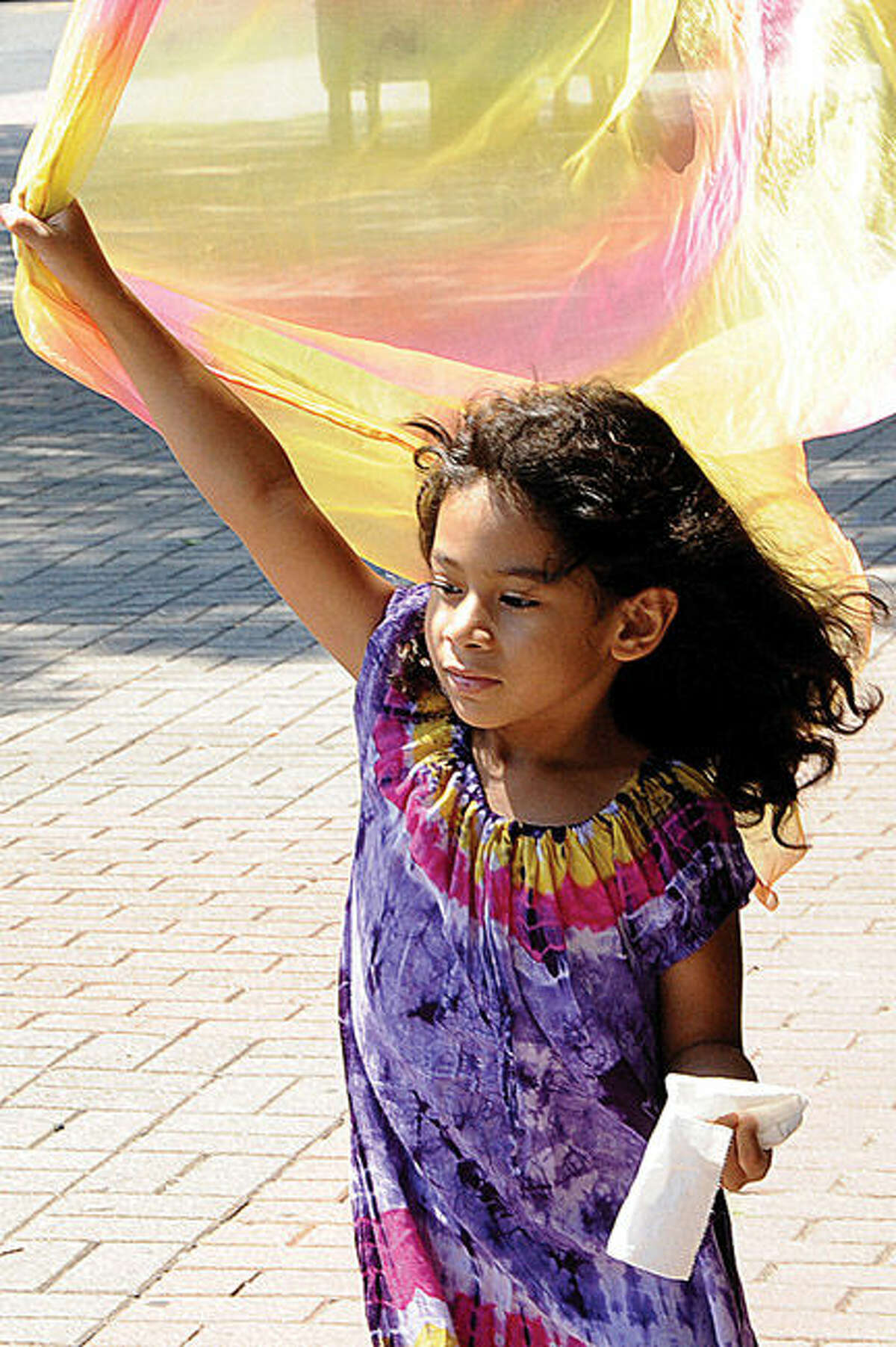 Lyilah Piro Vanegas 5, stepping out in the SoNo Arts puppet parade on Sunday. Hour phot/Matthew Vinci