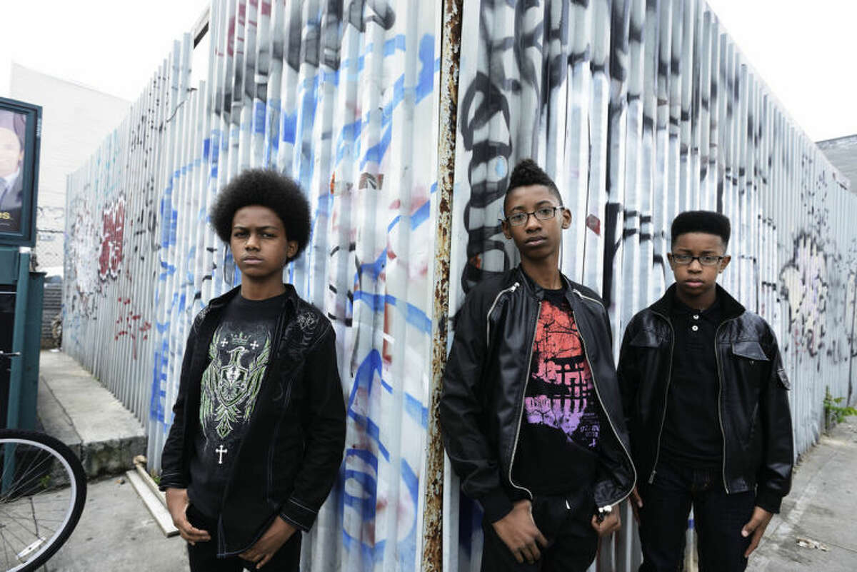 """This image released by Penguin Young Readers Group shows, from left, Malcolm Brickhouse, Alec Atkins and Jarad Dawkins of the teen metal band Unlocking the Truth. The band recently signed a multi-album deal with Sony and plans to release a book next year. The book written by the Brooklyn trio, will chronicle the group's """"path to success."""" Unlocking the Truth is signed to the new label The Cherry Party, a division of Sony. (AP Photo/Penguin Young Readers Group, Phil Knott)"""
