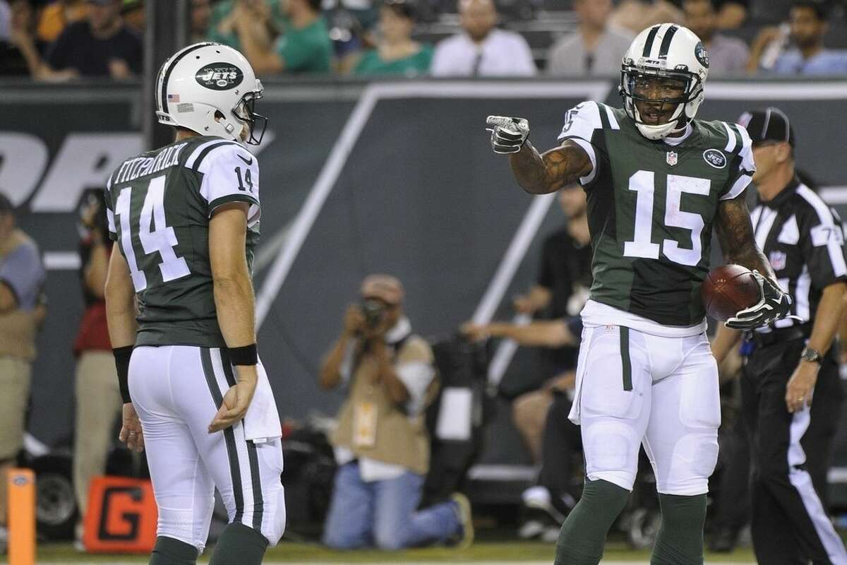 New York Jets wide receiver Brandon Marshall (15) gestures to quarterback Ryan Fitzpatrick (14) after they teamed up on a 2-point conversion during the first half of a preseason NFL football game against the Atlanta Falcons on Friday, Aug. 21, 2015, in East Rutherford, N.J. (AP Photo/Bill Kostroun)