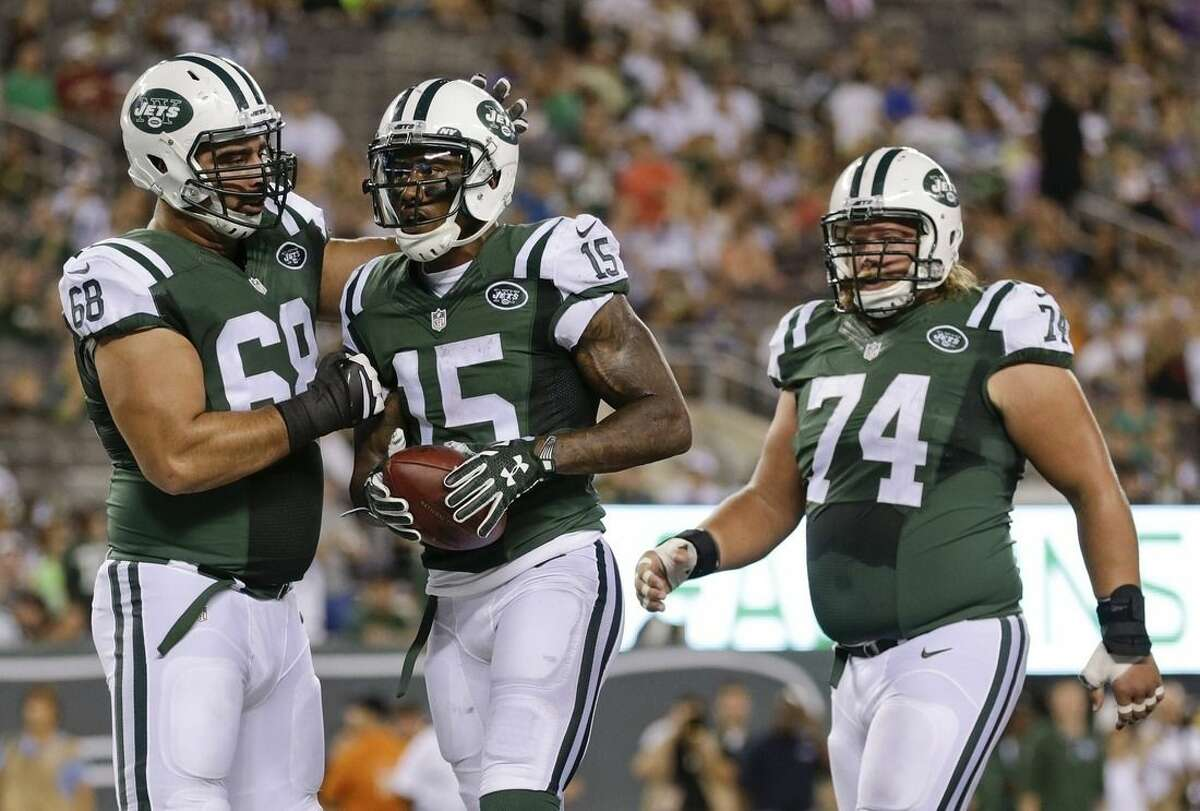 New York Jets' Breno Giacomini (68) and Nick Mangold (74) celebrate with Brandon Marshall (15) after Marshall's catch for a two point conversion during the first half of a preseason NFL football game against the Atlanta Falcons Friday, Aug. 21, 2015, in East Rutherford, N.J. (AP Photo/Adam Hunger)