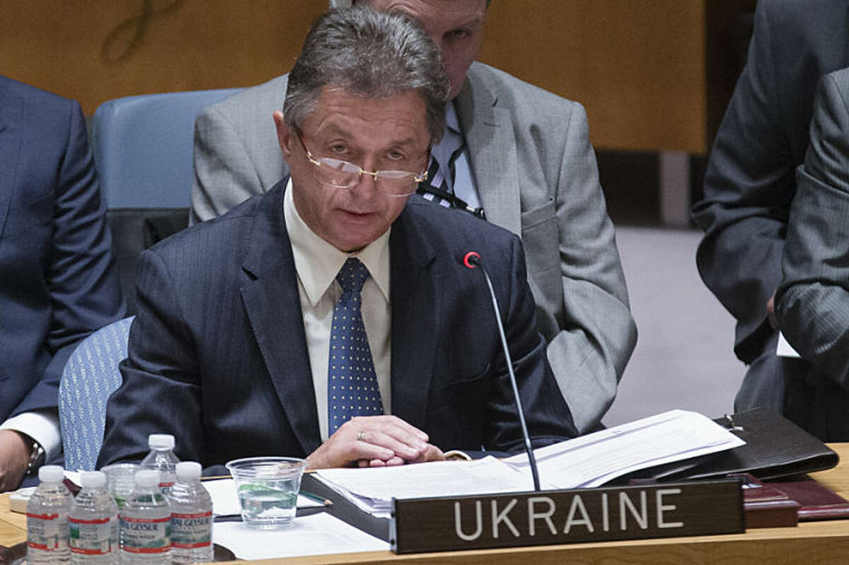 Ukrainian U.N. Ambassador Yuriy Sergeyev speaks during a U.N. Security Council meeting at United Nations headquarters, Friday, July 18, 2014. Britain's U.N. Mission says it requested an emergency meeting after Thursday's downing of a Malaysia Airlines plane carrying 298 people over eastern Ukraine. (AP Photo/John Minchillo)