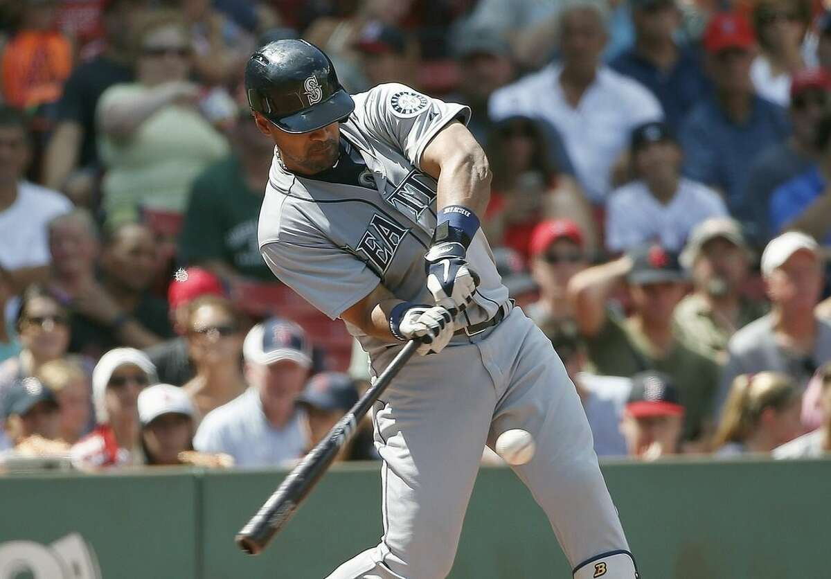 Seattle Mariners' Franklin Gutierrez hits a three-run home run during the third inning of a baseball game against the Boston Red Sox in Boston, Sunday, Aug. 16, 2015. (AP Photo/Michael Dwyer)