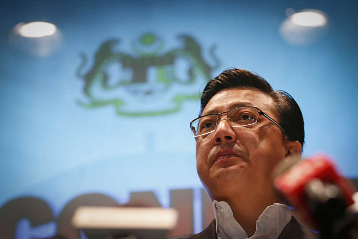 Malaysian Transport Minister Liow Tiong Lai speaks about Malaysia Airlines Flight 17 during a press conference at a hotel next to Kuala Lumpur International Airport in Sepang, Malaysia, Friday, July 18, 2014. The Malaysia Airlines jetliner that went down in war-torn Ukraine did not make any distress call, Malaysia's prime minister said Friday, adding that its flight route had been declared safe by the global civil aviation body. (AP Photo/Vincent Thian)