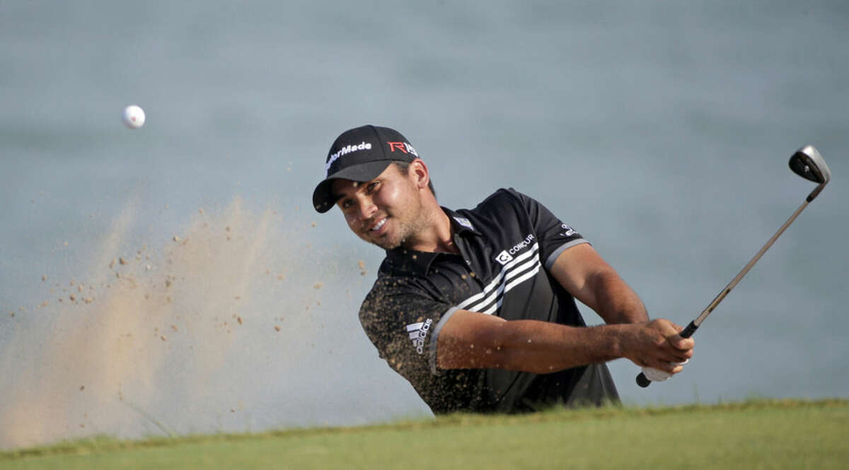 Jason Day, of Australia, hits out of a bunker on the 12th hole during the fourth round of the PGA Championship golf tournament Sunday, Aug. 16, 2015, at Whistling Straits in Haven, Wis. (AP Photo/Jae Hong)