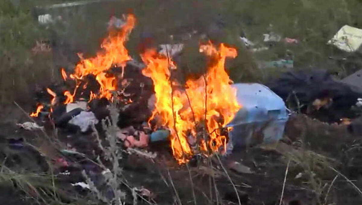 In this image taken from video, Thursday July 17, 2014, showing flames rising from part of the wreckage of a passenger plane carrying 295 people after it was shot down Thursday as it flew over Ukraine, near the village of Hrabove, in eastern Ukraine. Malaysia Airlines tweeted that it lost contact with one of its flights as it was traveling from Amsterdam to Kuala Lumpur over Ukrainian airspace. (AP Photo / Channel 1) RUSSIA OUT - TV OUT
