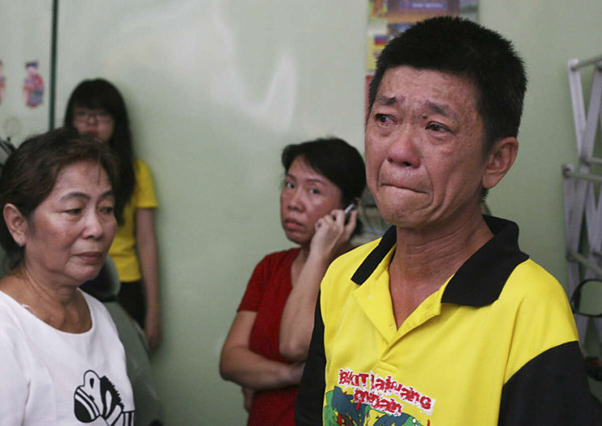 A relative of Hendry, an Indonesian passenger of the crashed Malaysia Airlines Flight 17, cries as he speaks to journalists in Medan, North Sumatra, Indonesia, Friday, July 18, 2014. The Malaysian jetliner that went down in war-torn Ukraine did not make any distress call, Malaysian Prime Minister Najib Razak said Friday, adding that its flight route had been declared safe by the global civil aviation body. (AP Photo/Binsar Bakkara)