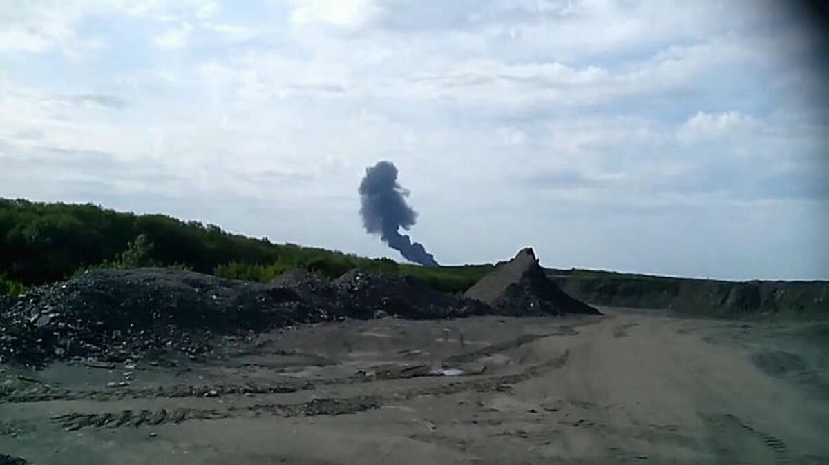 In this image taken from amateur video, Thursday July 17, 2014, Smoke rises from a fireball is seen in the distance shortly after a Malaysia Airlines passenger plane carrying 295 people was shot down Thursday as it flew over Ukraine, and plumes of black smoke rose up from the scene near the rebel-held village of Grabovo, in eastern Ukraine. Malaysia Airlines has tweeted that it lost contact with one of its flights as it was traveling from Amsterdam to Kuala Lumpur over Ukrainian airspace. (AP Photo / Amateur Video accessed by APTV) TV OUT
