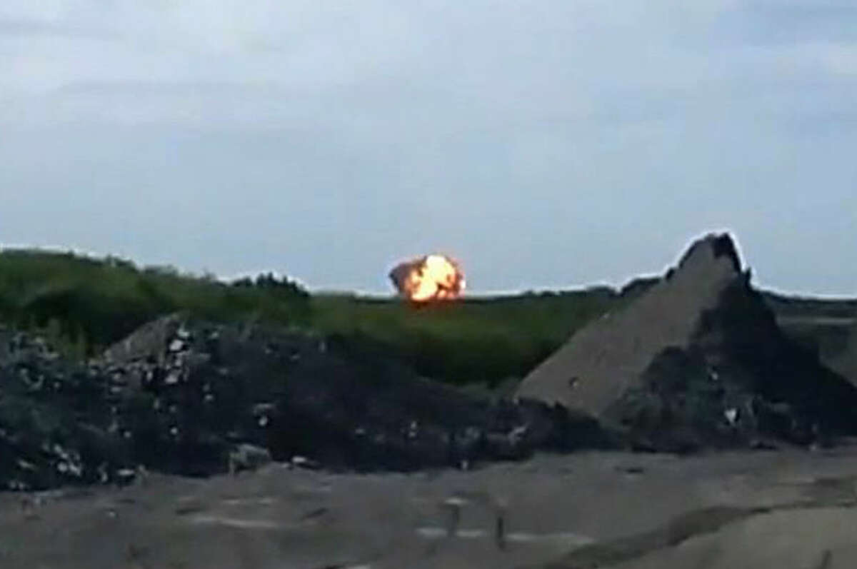 RECROP TO ENLARGE CENTRAL PART OF IMAGE - In this image taken from amateur video, Thursday July 17, 2014, a fireball is seen shortly after a Malaysia Airlines passenger plane carrying 295 people was shot down Thursday as it flew over Ukraine, and plumes of black smoke rose up from the scene near the rebel-held village of Grabovo, in eastern Ukraine. Malaysia Airlines has tweeted that it lost contact with one of its flights as it was traveling from Amsterdam to Kuala Lumpur over Ukrainian airspace. (AP Photo / Amateur Video accessed by APTV) TV OUT