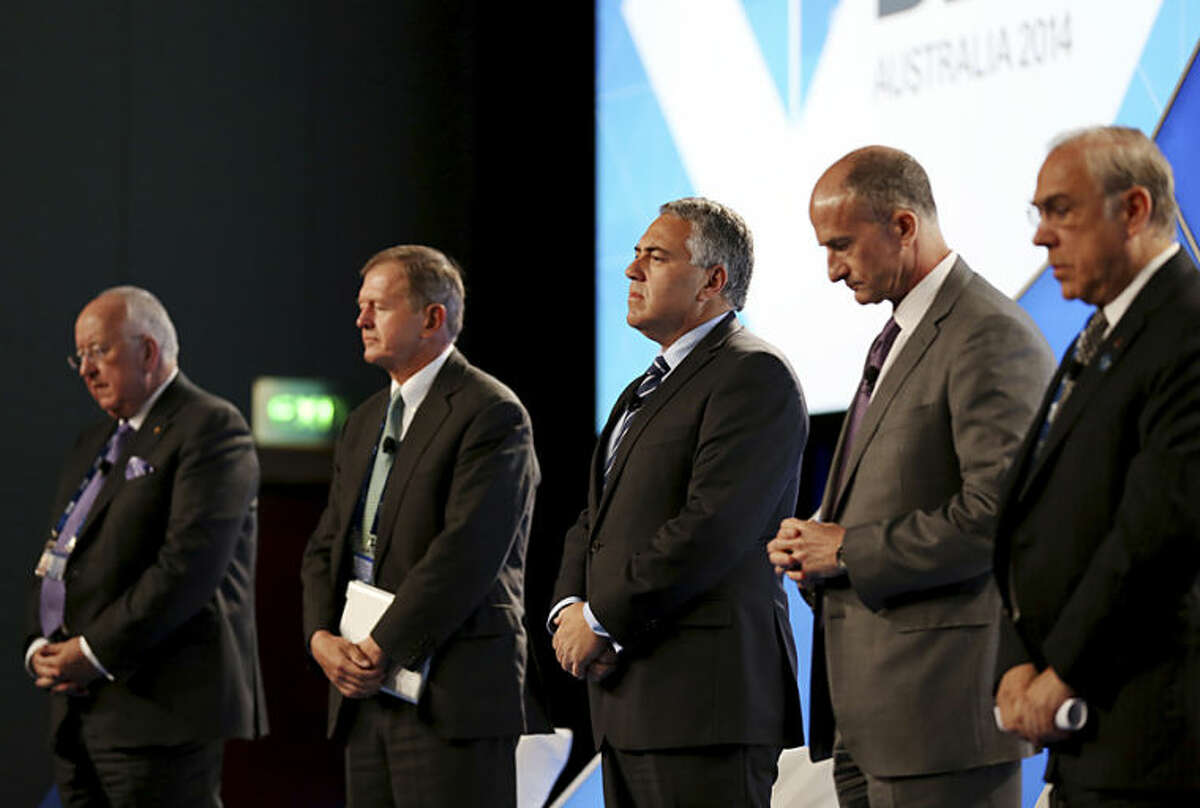 From left, Rio Tinto CEO Sam Walsh, SEB, or Skandinaviska Enskilda Banken Chairman Marcus Wallenberg, Treasurer of Australia Joe Hockey, GE Global Growth and Operations CEO John Rice and OECD Secretary-General Angel Gurria hold a minute of silence for the victims of Malaysia Airlines flight MH17 that went down in war-torn Ukraine, at the B20 Australia Summit in Sydney, Friday, July 18, 2014. (AP Photo/Nikki Short, Pool)