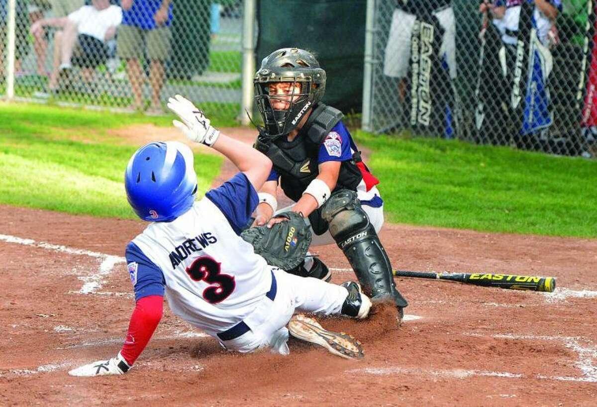 Hour Photo/Alex von Kleydorff Norwalks #12 Mitchell Stiles makes the out at home plate verses Fairfields #3 Jack Andrews.