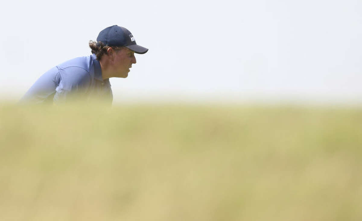 Phil Mickelson of the US prepares to putt on the 12th green during the second day of the British Open Golf championship at the Royal Liverpool golf club, Hoylake, England, Friday July 18, 2014. (AP Photo/Scott Heppell)