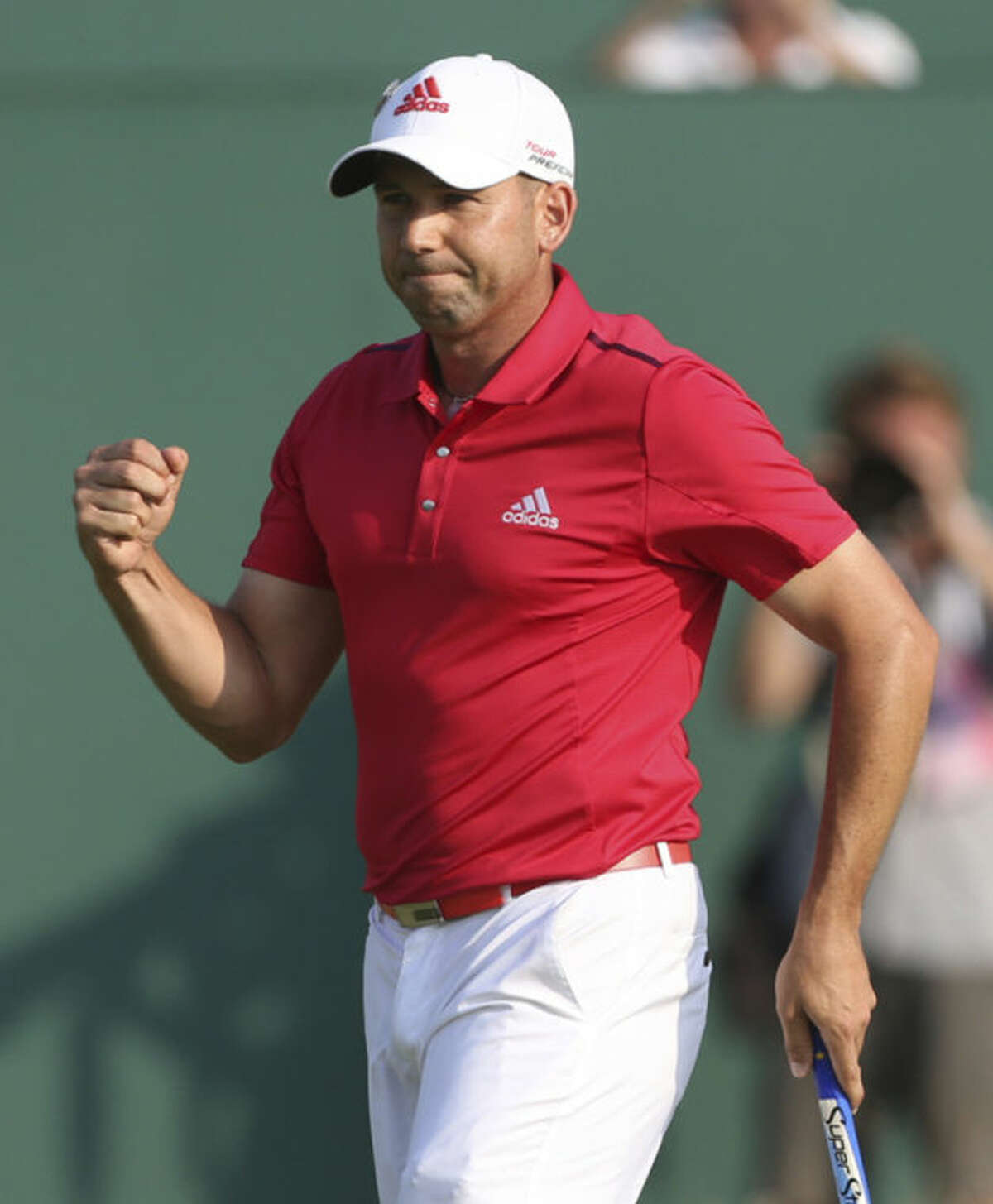 Sergio Garcia of Spain celebrates on the 18th green after finishing his round on the second day of the British Open Golf championship at the Royal Liverpool golf club, Hoylake, England, Friday July 18, 2014. (AP Photo/Peter Morrison)