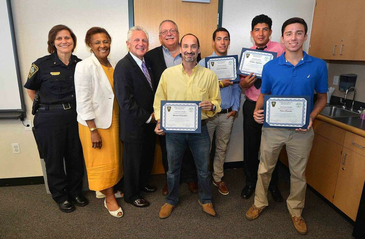Hour Photo/Alex von Kleydorff L-R Deputy Chief Susan Zecca, Police Commissioner Fran Collier-Clemmons, and Mayor Harry Rilling, Commissioner Charles Yost present father Alvaro Gonzalez, lifeguards Juan Gonzalez, Calos Aspiazu and Nico Osorio with certificates for their efforts in chasing and catching a thief who stole a purse at Calf Pasture beach.