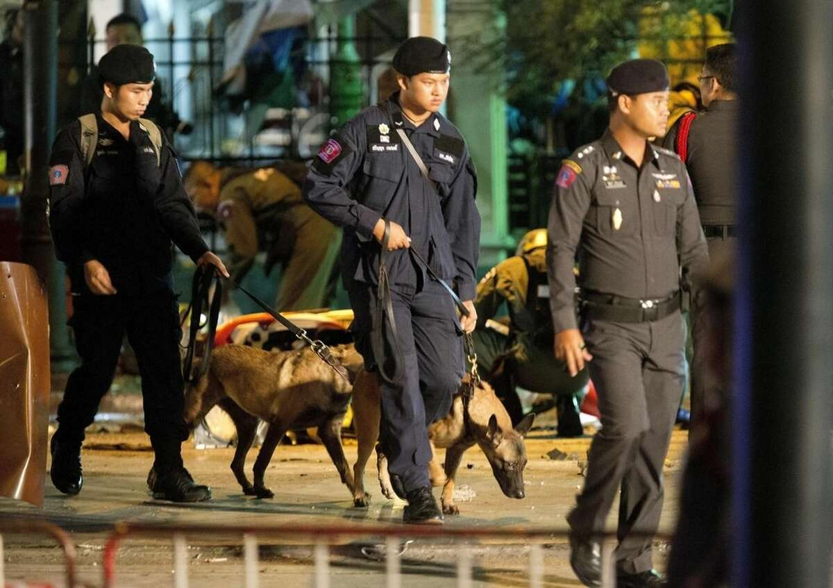 Police investigate the scene after an explosion in Bangkok, Monday, Aug. 17, 2015. A large explosion rocked a central Bangkok intersection during the evening rush hour, killing a number of people and injuring others, police said(AP Photo/Mark Baker)