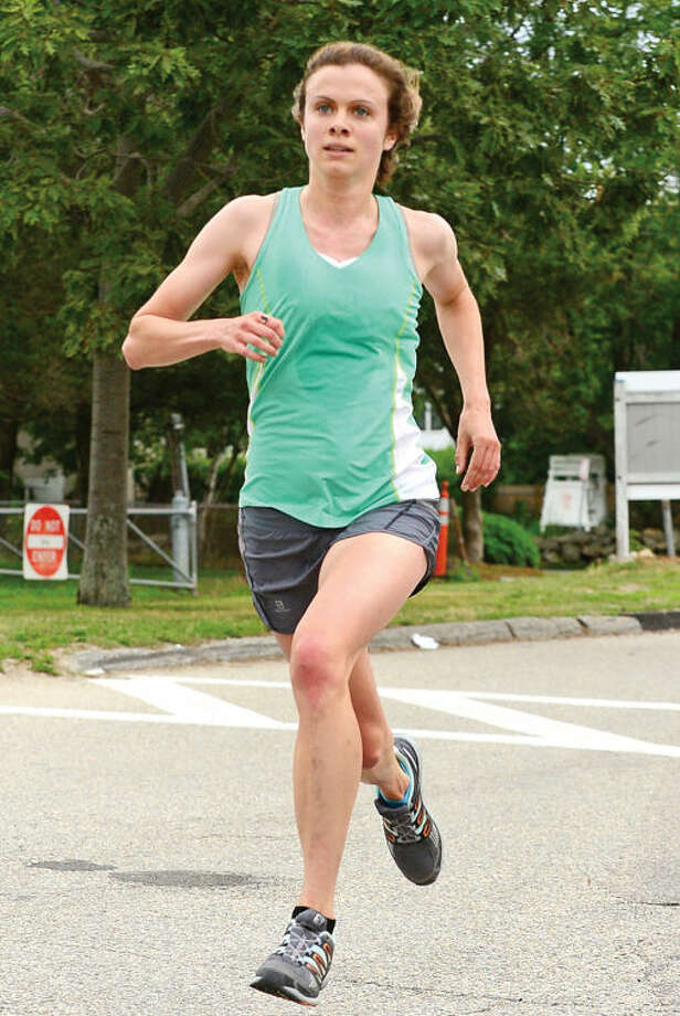 Hour photo / Erik Trautmann Kerry Lyons finishes first for the women in the Westport Road Runners race no. 4, a 4.1 miler, at Compo Beach Saturday.
