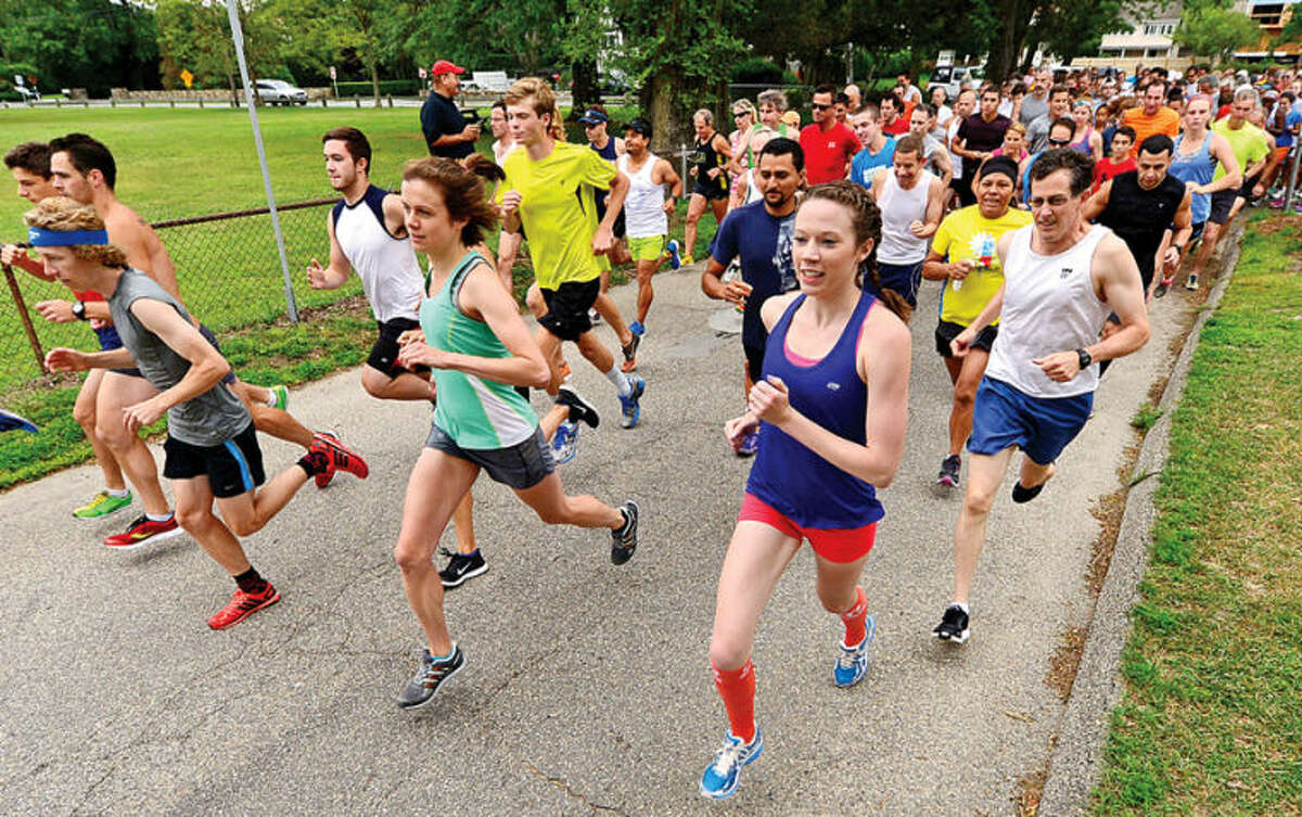 Hour photo / Erik Trautmann Runners set out in the Westport Road Runners race no. 4, a 4.1 miler, at Compo Beach Saturday.