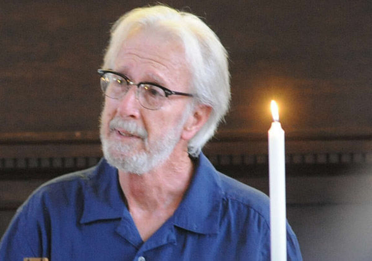 Frank Glick, deacon at First Congregational Church in Norwalk speaks Monday at the the vigil held in Norwalk for former Norwalkers, Ledell and Katherine Mulvaney, who were killed in auto accident on the Taconic Parkway on Saturday. Hour Photo/Matthew Vinci