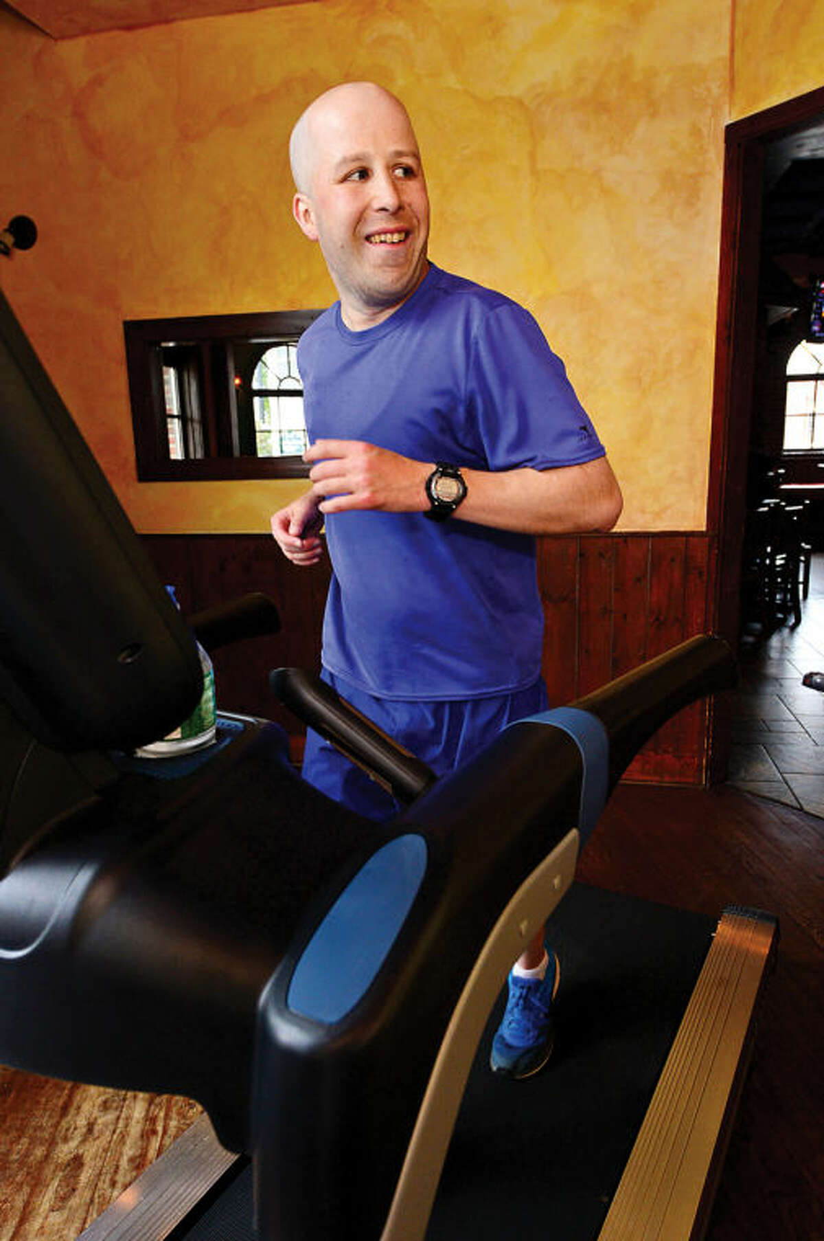 """Norwalk resident Jimmy Booth participates in the """"Run in the Pub"""" charity event at O'Neill's Pub saturday. Booth runs the marthon on a treadmill to benefit the Open Door Shelter and Jo Mazzo's Time to Fight fund."""