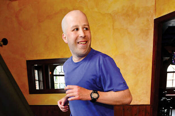 "Norwalk resident Jimmy Booth participates in the ""Run in the Pub"" charity event at O'Neill's Pub saturday. Booth runs the marthon on a treadmill to benefit the Open Door Shelter and Jo Mazzo's Time to Fight fund."