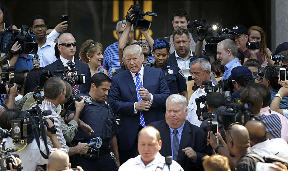 Republican presidential candidate Donald Trump leaves for lunch after being summoned for jury duty in New York, Monday, Aug. 17, 2015. Trump was due to report for jury duty Monday in Manhattan. The front-runner said last week before a rally in New Hampshire that he would willingly take a break from the campaign trail to answer the summons. (AP Photo/Seth Wenig)