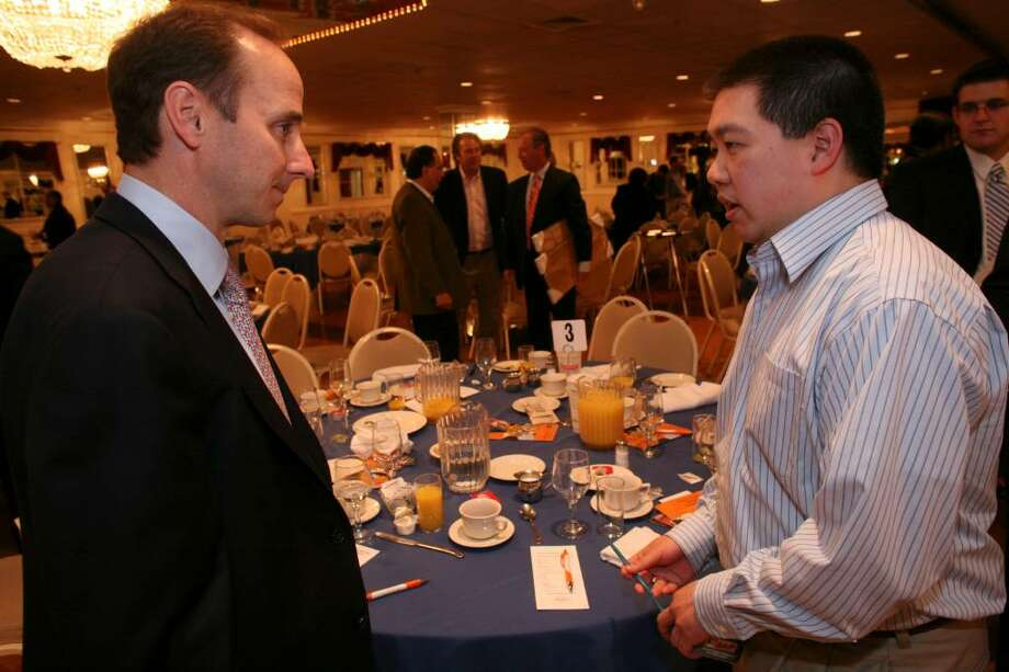 Bill Chin of Trumbull had the opportunity to speak with New York Yankees General Manager Brian Cashman after Thrusday mornings Fairfield County Sports Commission 3rd Annual Celebrity Breakfast in Norwalk. Photo: David Ames / Stamford Advocate