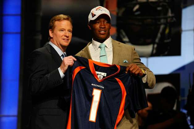 NEW YORK - APRIL 22:  Demaryius Thomas from the Georgia Tech Yellow Jackets poses with NFL Commissioner Roger Goodell as they hold up a Denver Broncos jersey after Thomas was drafted by the Broncos number 22 overall during the the first round of the 2010 NFL Draft at Radio City Music Hall on April 22, 2010 in New York City.  (Photo by Jeff Zelevansky/Getty Images) *** Local Caption *** Demaryius Thomas;Roger Goodell Photo: Jeff Zelevansky, Getty Images / 2010 Getty Images