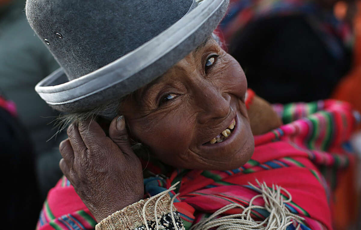 An Aymara indigenous woman wearing a shawl made of alpaca wool attends a fashion show featuring clothing made of local alpaca and llama wool, at the annual Camelid Expo fair in El Alto, Bolivia, Sunday, Aug. 16, 2015. The herding of cameloids like alpacas, llamas and vicunas has been a major highland activity since 4000 B.C., providing indigenous civilizations with a reliable and sustainable supply of wool, meat, fertilizer and heat. (AP Photo/Juan Karita)